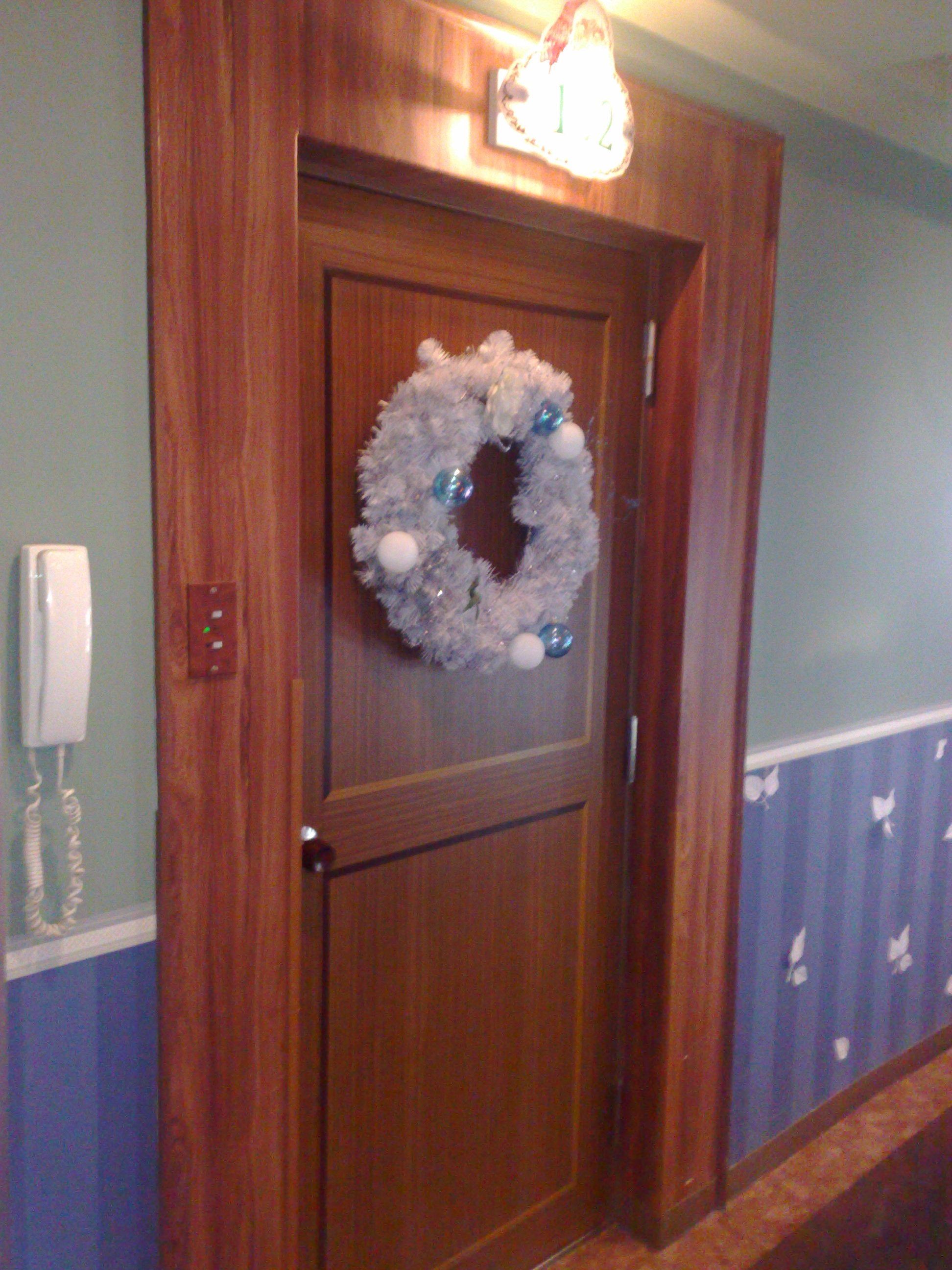 Inside Hotel Room Door: A Christmas-themed Love Motel
